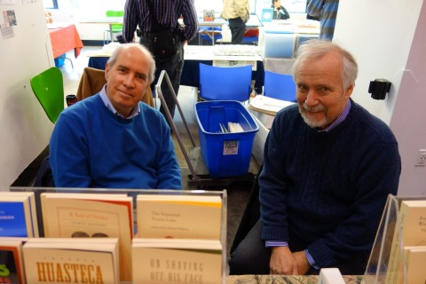Curator and author Tom Smart helps publisher Tim Inkster man the PQL/DA table.