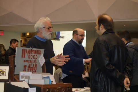 Wood engraver, artist, and publisher Alan Stein of Church Street Press, Parry Sound, Ont., chats to a customer.