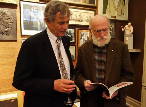 Master of Ceremonies Chester Gryski and Coach House Books founder Stan Bevington examine the goods.