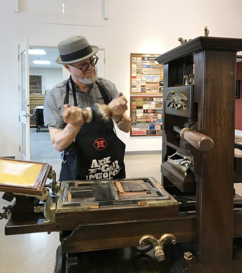 George on wooden press.