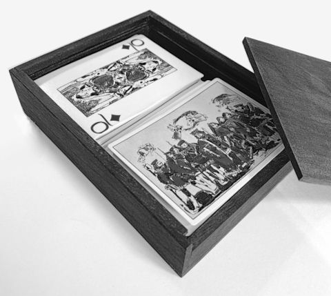 The set of decks, showing recto and verso cards, displayed in a custom-made wooden box.